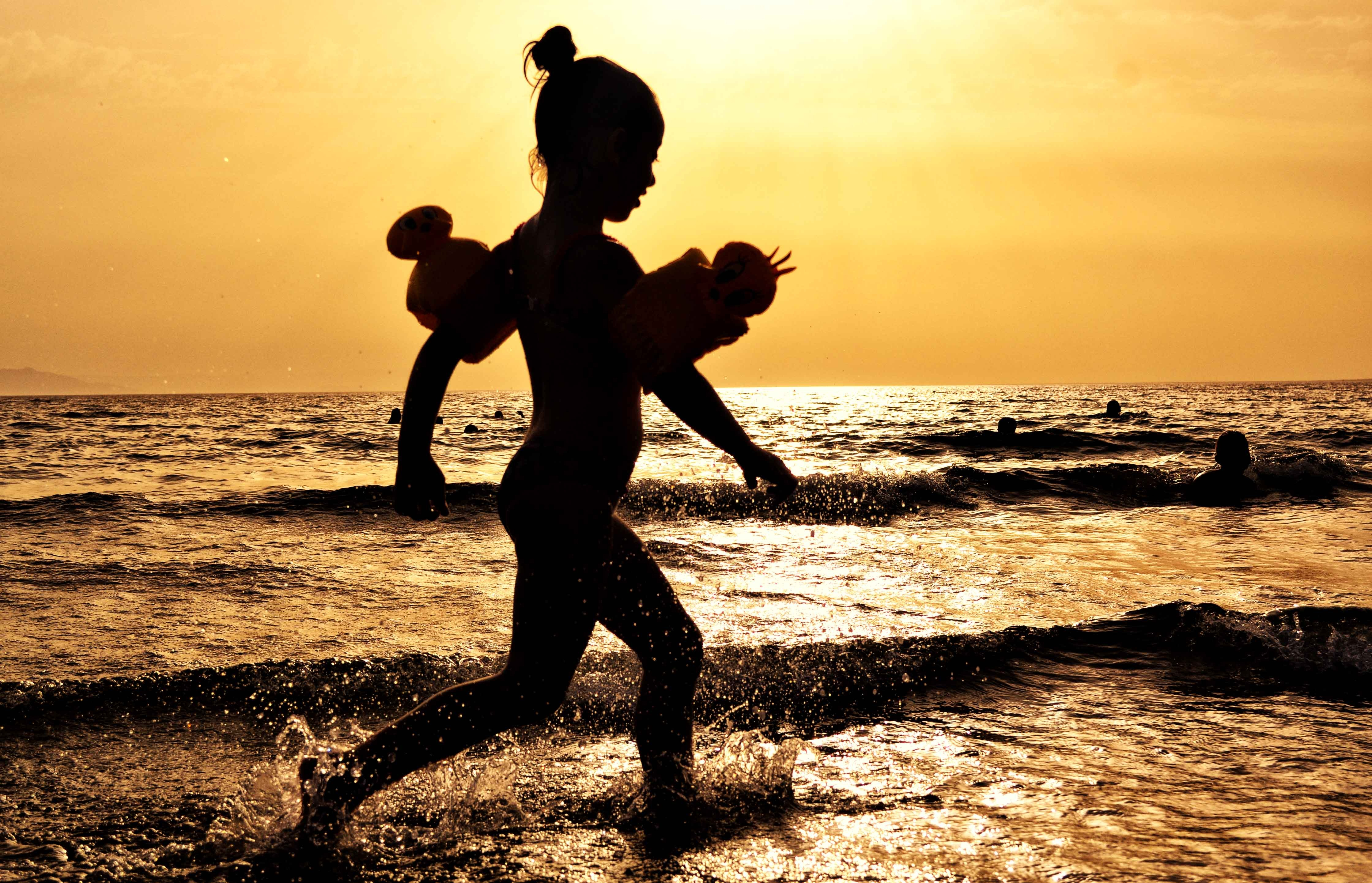 Canva - Silhouette of Girl Running on the Seashore during Golden Hour