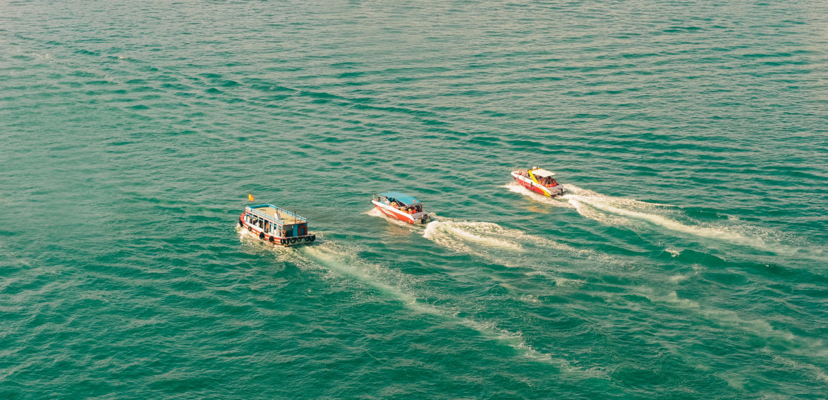 Canva - Three Speedboats Aerial Photography