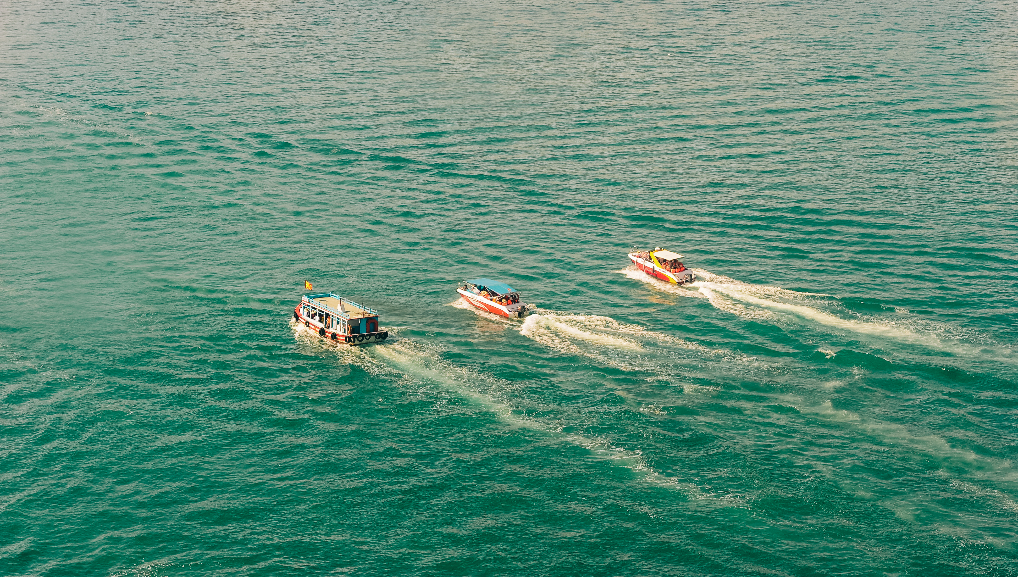 Canva - Three Speedboats Aerial Photography